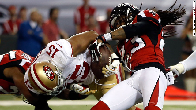 Dunta Robinson of the Falcons forces Michael Crabtree of the 49ers to fumble.