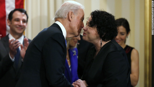 Vice President Joe Biden kisses Supreme Court Justice Sonia Sotomayor after she administered the oath of office to him Sunday.