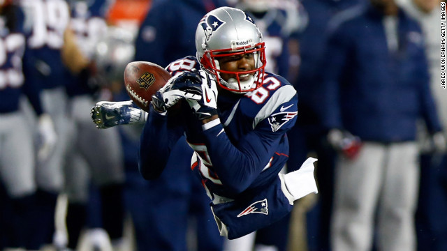 Brandon Lloyd of the New England Patriots misses a catch during Sunday's game against the Baltimore Ravens.
