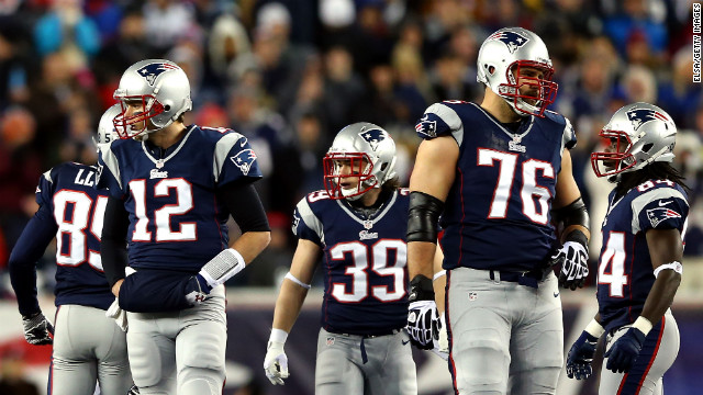 From left, Brandon Lloyd, Tom Brady, Danny Woodhead, Sebastian Vollmer and Deion Branch of the New England Patriots look on during the game against the Baltimore Ravens.
