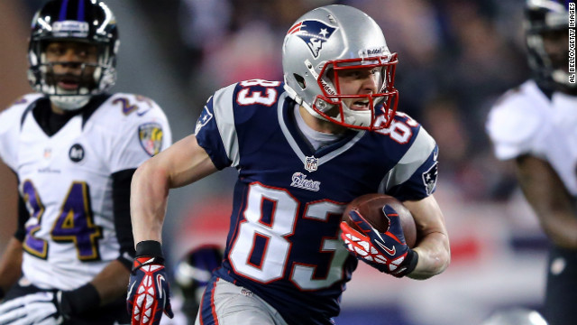 Wes Welker of the New England Patriots runs the ball after making a catch against the Baltimore Ravens.