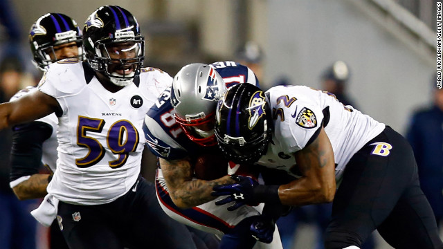 Aaron Hernandez of the Patriots gets tackled by Ray Lewis of the Baltimore Ravens.