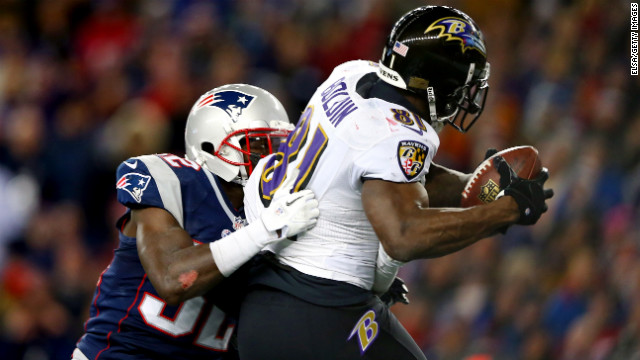 Ravens wide receiver Anquan Boldin scores a touchdown against Devin McCourty of the Patriots.