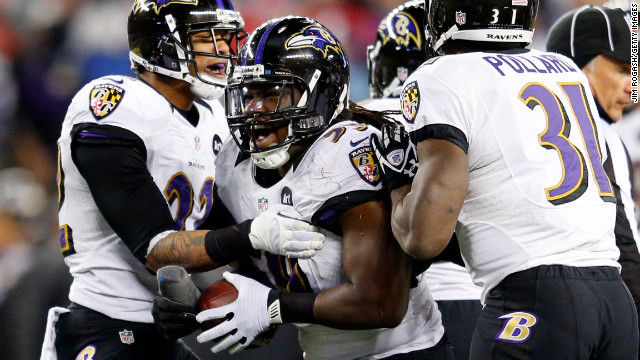 Dannell Ellerbe of the Baltimore Ravens celebrates with his teammates after intercepting a pass by Patriots quarterback Tom Brady.