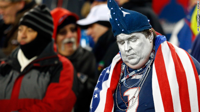 A New England Patriots fan reacts to a play during the AFC Championship game.