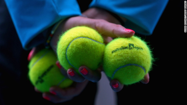 A ball kid displays Australian Open tennis balls during a match on January 21 at Melbourne Park.