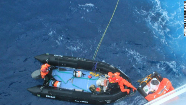 Delord is dragged from his life raft onto the rescue boat. He had been in the raft for almost 3 days.