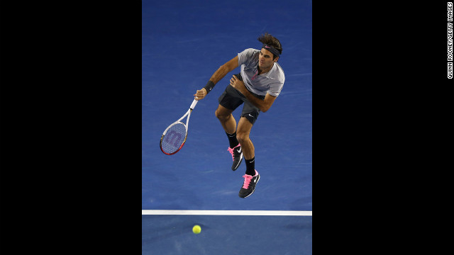 Roger Federer of Switzerland serves in his fourth-round match against Canadian Milos Raonic on January 21. Federer won 6-4, 7-6(4), 6-2.