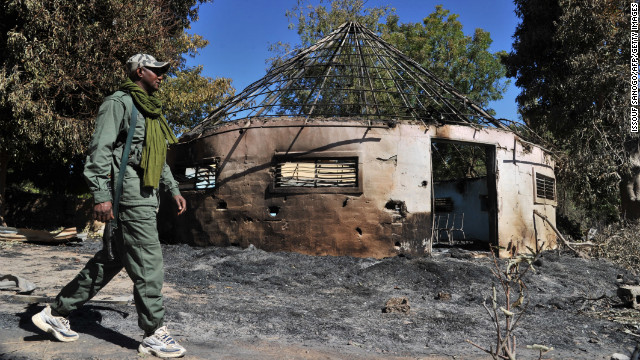 A Malian soldier walks past a army building that was taken by the jihadists before being destroyed during aerial bombing in Diabaly on January 21.