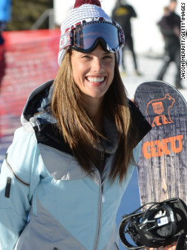 Alessandra Ambrosio goes snowboarding.