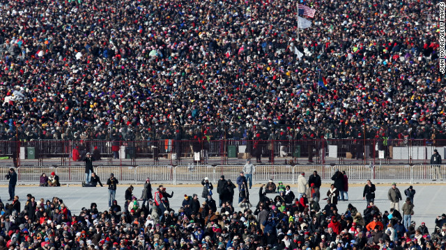Crowds await the start of the presidential inauguration Monday on the Capitol's West Front .