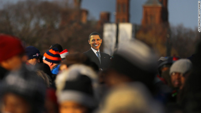 A presidential cutout rises above the crowd gathering Monday near the Capitol.
