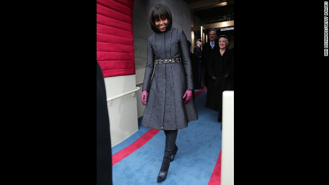 "For Inauguration Day, first lady Michelle Obama mixed ""high"" and ""low"" fashion with a belt from J. Crew, coat and dress by Thom Browne, Reed Krakoff boots and necklace by Cathy Waterman, the White House said. After the Inaugural festivities, the outfit and accompanying accessories will go to the National Archives."