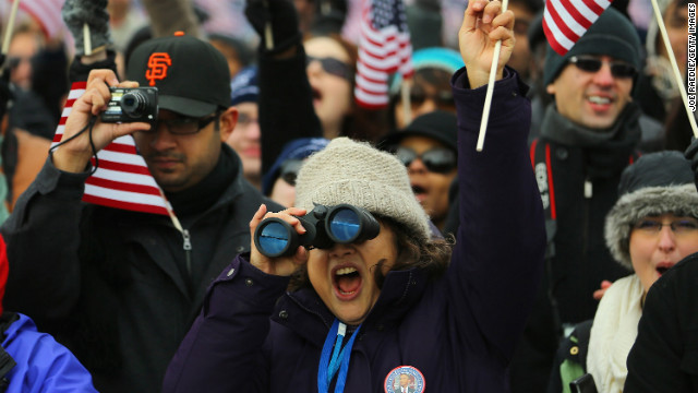 People watch from the National Mall as Obama is sworn in on January 21.