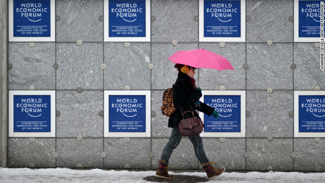 A woman passes the congress center on January 21, 2013 at the Swiss resort of Davos.