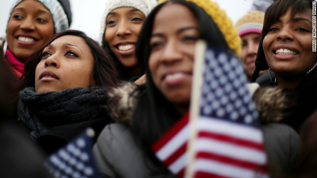 Left to right, Donica Perez, Janelle Stewart, Shani Perez, Kinda Romero and Danielle Houston watch the Inauguration on the Jumbotron near the U.S. Capitol building on the National Mall.
