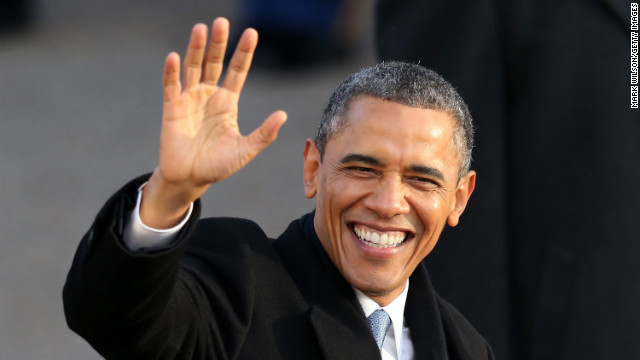 President Obama waves as the presidential inaugural parade winds through the nation's capital on Monday.
