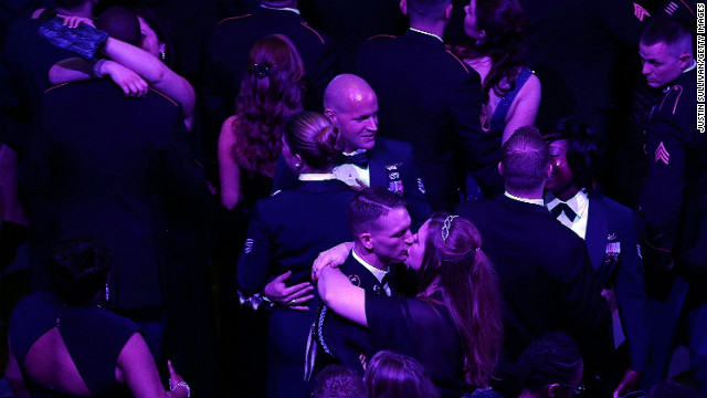 Couples dance at the Commander-in-Chief's Ball as they wait for the arrival of President Obama.