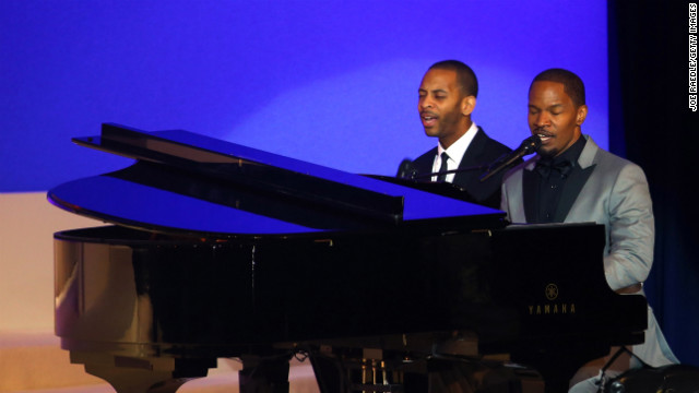 Jamie Foxx, right, sings Ray Charles' &quot;I Can't Stop Loving You&quot; during the first dance of Vice President Joe Biden and Jill Biden at the Commander-in-Chief's Ball. Foxx earned an Oscar playing the late Ray Charles in the 2004 film &quot;Ray.&quot;