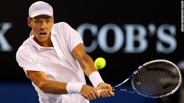 Berdych plays a backhand in his match against Djokovic on January 22.