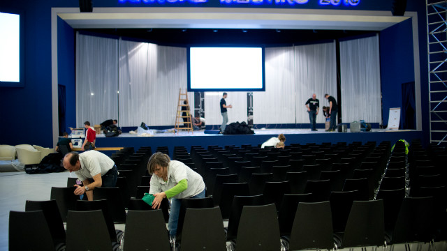 Employees clean the chairs in the main hall at the congress center on January 21, 2013 at the Swiss resort of Davos.