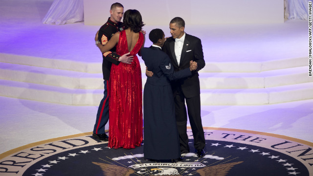 President Obama and the first lady dance with service members.