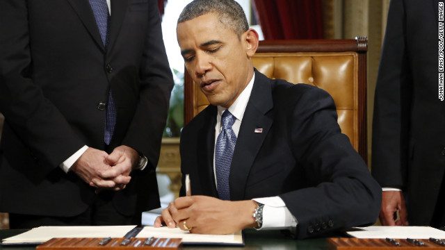 Obama signs nominations for Sen. John Kerry as secretary of state, White House Chief of Staff Jacob Lew as treasury secretary, former Sen. Chuck Hagel as defense secretary and John Brennan as CIA director after swearing-in ceremonies at the Capitol on January 21.