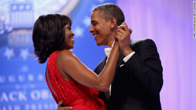 The president and his wife dance together on stage.