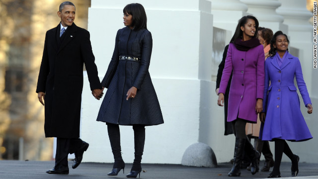 The Obamas walk to the reviewing stand for the inaugural parade January 21.