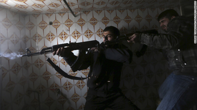 Fighters from Fateh al Sham unit of the Free Syrian Army fire on Syrian Army soldiers at a check point in Damascus on January 20.