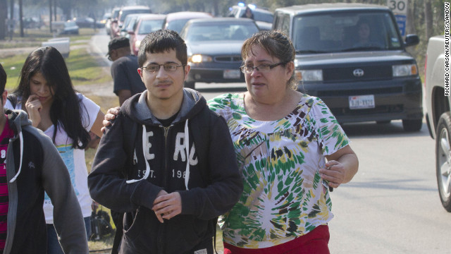A mother joins her son as he evacuates the campus on foot.