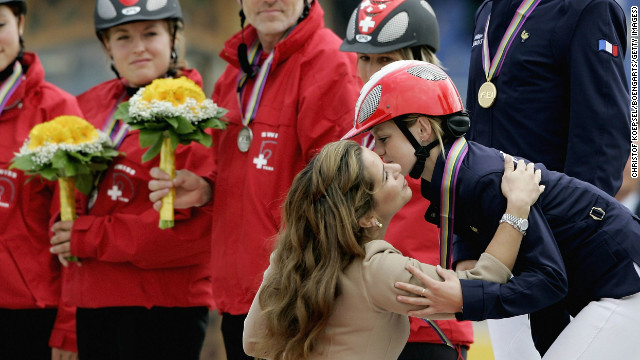 Princess Haya congratulates Virgine Atger, a member of the winning French team at the World Equestrian Games in Aachen in Germany in 2006.