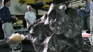 Meteorites sit on a display table Tuesday at the Deep Space Industries announcement of plans for the world\'s first fleet of commercial asteroid-prospecting spacecraft at the Museum of Flying in Santa Monica, California.