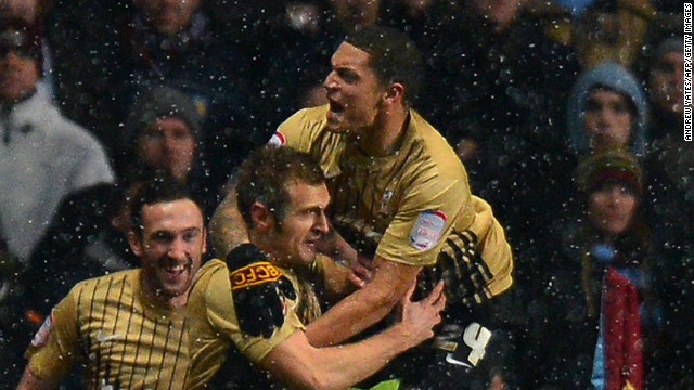 Bradford celebrates its equalizer during the 1-1 draw at Villa Park.