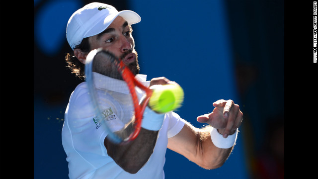 France's Jeremy Chardy hits a return against Britain's Andy Murray during their men's singles match on January 23. Murray defeated Chardy 6-4, 6-1, 6-2.