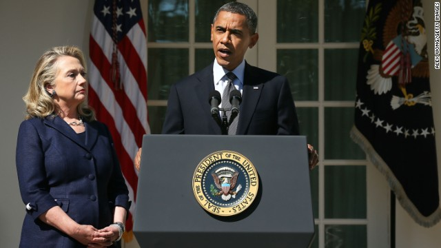 Clinton looks on as Obama makes a statement in response to the attack at the U.S. Consulate in Libya on September 12, 2012.