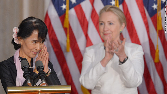 Clinton applauds Myanmar opposition leader Aung San Suu Kyi during a ceremony where Suu Kyi was presented with the Congressional Gold Medal on September 19, 2012.