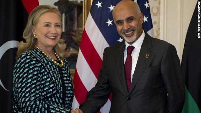 Clinton shakes hands with Libyan President Mohamed Magariaf on September 24, 2012, in New York.