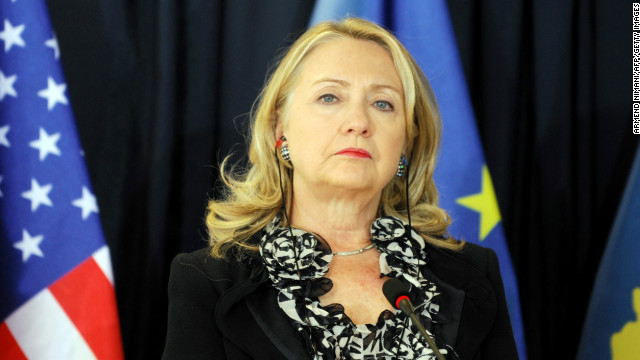 "Clinton stands during a news conference following meetings at the prime minister's office in Pristina, Kosovo, on October 31, 2012. Clinton said that Kosovo's unilaterally declared independence, fiercely opposed by Serbia, was ""not up for discussion."""
