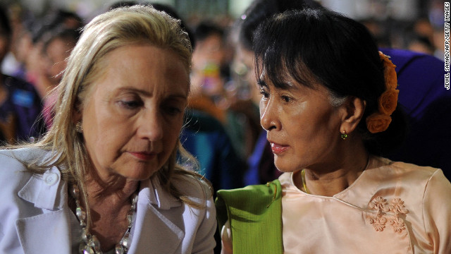 Clinton chats with Myanmar opposition leader Aung San Suu Kyi before President Barack Obama speaks at the University of Yangon in Yangon on November 19, 2012.