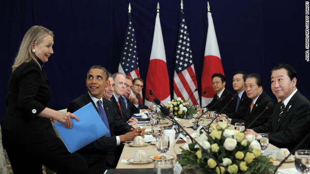 Obama looks at Clinton before the start of a bilateral meeting with Japanese Prime Minister Yoshihiko Noda, far right, during the East Asian Summit in Phnom Penh, Cambodia, on November 20, 2012.