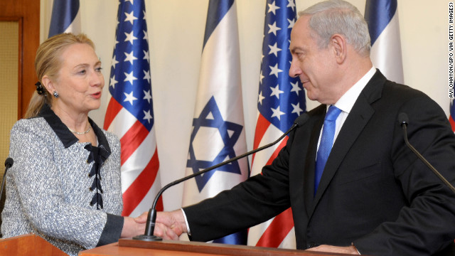Israeli Prime Minister Benjamin Netanyahu shakes hands with Clinton at the prime minister's office November 20, 2012 in Jerusalem, Israel. Clinton arrived in Israel as efforts by Western and Arab diplomats to end the confrontation between Israel and Gaza have escalated.