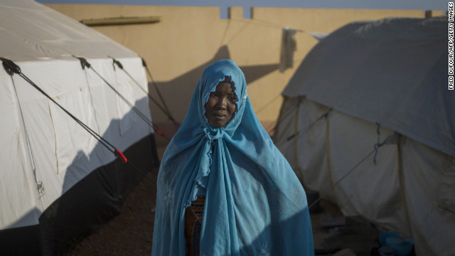 A woman who fled northern Mali sits at a camp for internally displaced persons in Sevare on Wednesday, January 23. The EU announced 20 million euros of extra humanitarian aid to help Malians fleeing fighting, its second such donation in as many months.
