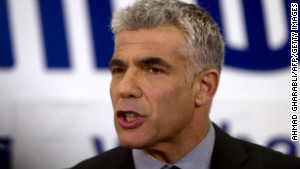 Yair Lapid\'s centrist party finished second in Israel\'s election. Will he join the prime minister or lead the political opposition?