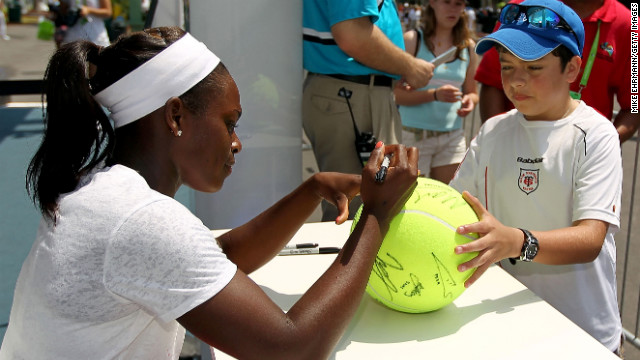 At the Sony Ericsson Open in 2011, Stephens signs an autograph for a young fan.