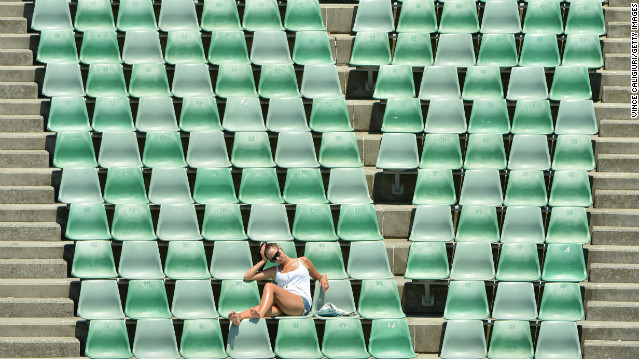 A tennis fan sits in the stands during Day 11 of the Australian Open at Melbourne Park on January 24.