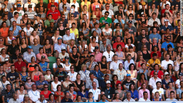 Fans watch the men's semifinal match between Ferrer and Djokovic on January 24.