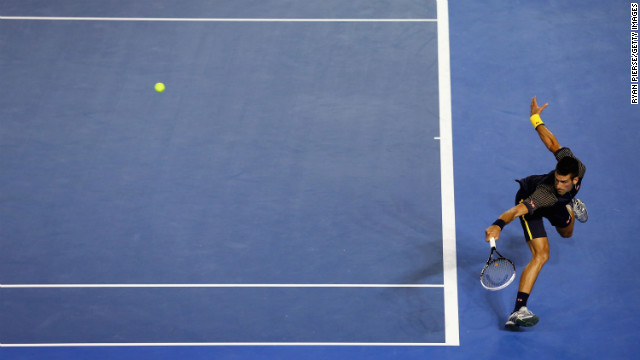Djokovic plays a backhand against Ferrer on January 24.