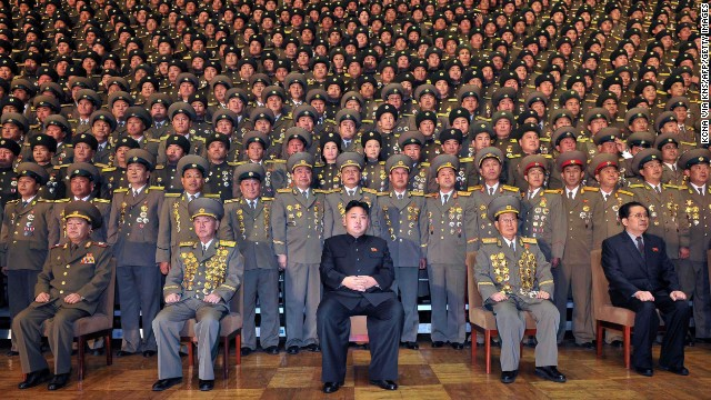 North Korean leader Kim Jong Un, center, poses with chiefs of branch social security stations in this undated picture released by North Korea's official news agency on November 27.