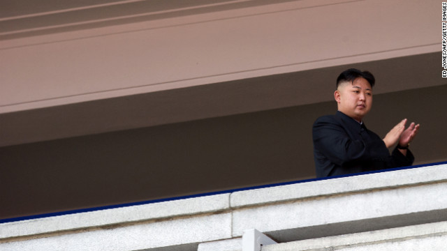 Kim Jong Un applauds as he watches a military parade in Pyongyang on April 15, 2012.